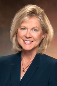 blonde woman in a blue jacket
