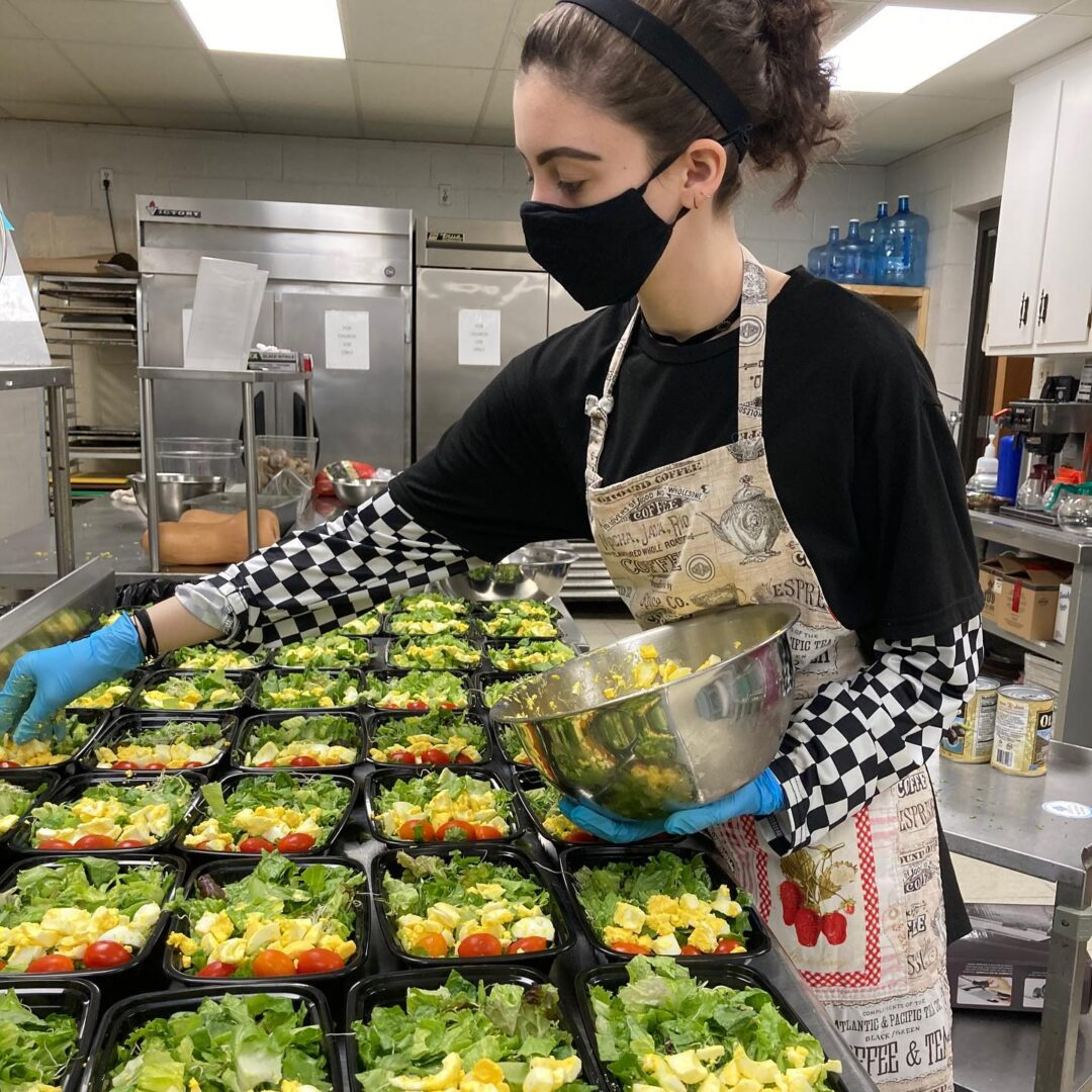 Teen Volunteer with Salad