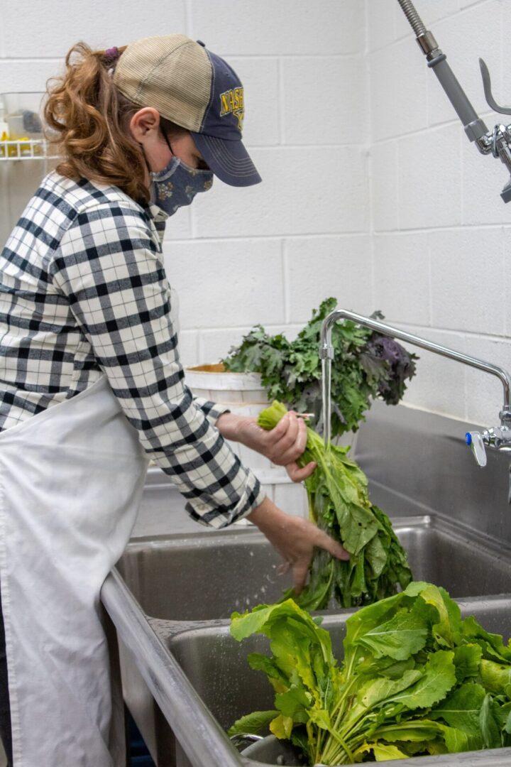 Volunteer washing lettuce